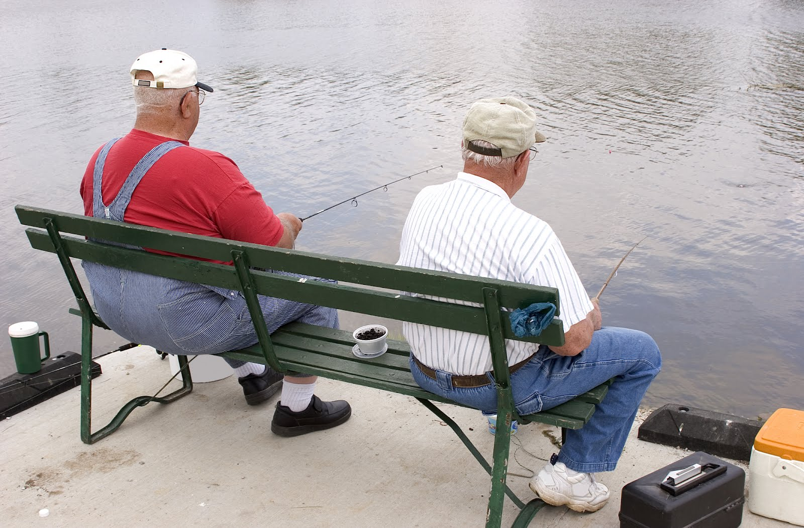 old guys fishing on park bench